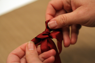 Tying a bow 4